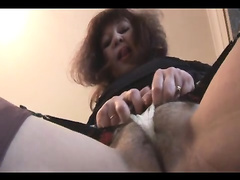 Mature housewife stripping for the camera