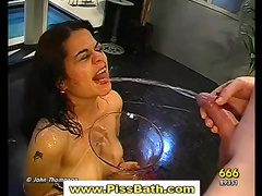 Real babe gets goldenshower and drinks piss in gangbang