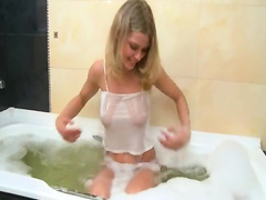 Bath pleasure of busty blonde woman