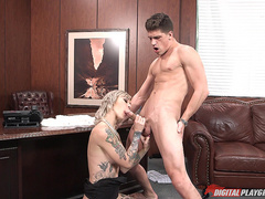 Tattooed slut Kleio Valentien sucking big cock in the office