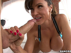 Busty Milf pornstar Lisa Ann gives a big dick a good blowjob