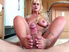 Busty step mom Ryan Conner gives footjob in the kitchen