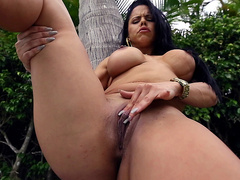 Sexy latina Diamond Kitty rubs and fingers her pussy outdoors