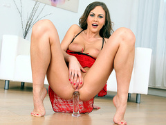 Tina Kay riding a glass dildo