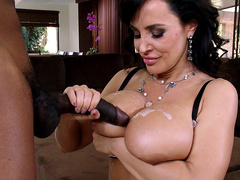 Lisa Ann takes a hot load of big black cock cum all over her large boobs