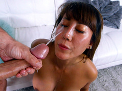 Asian milf Tiffany Rain gets blinded with cumshots to her eyes