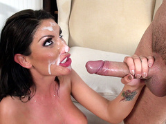 August Ames gets a huge mess of white creamy cum all over her face