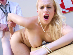 Blonde Angel Wicky leaned on the table and gets pounded