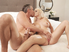 Busty blonde Aspen Romanoff gives nice handjob