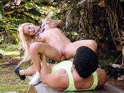 Kenzie Reeves riding Bambino on picnic table