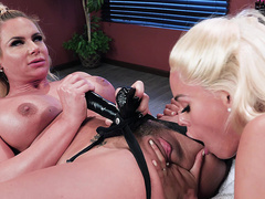 Luna Star eats out Phoenix Marie's pussy under her strapon