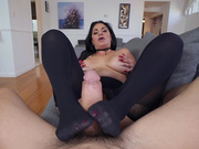 Lovely Cristal Caraballo likes to stroke big cock with her feet