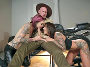 Biker babes Anna Bell Peaks and Felicity Feline sucking an officer's big cock