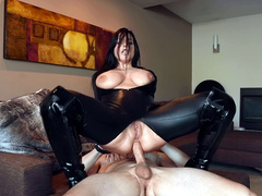 Angela White dressed in black leather rides hard cock in her ass