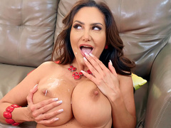 Busty milf Ava Addams spreads her facial cumshot all over her big boobs