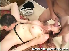 Big tits milf takes on two guys in a threesome